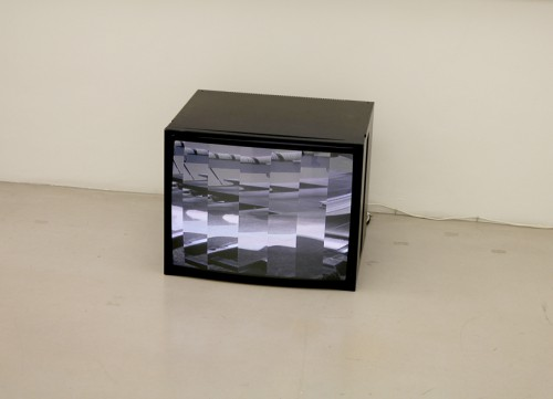 Machine Cutting Image, 2017. Video loop. Exhibition view, MUSA Vienna